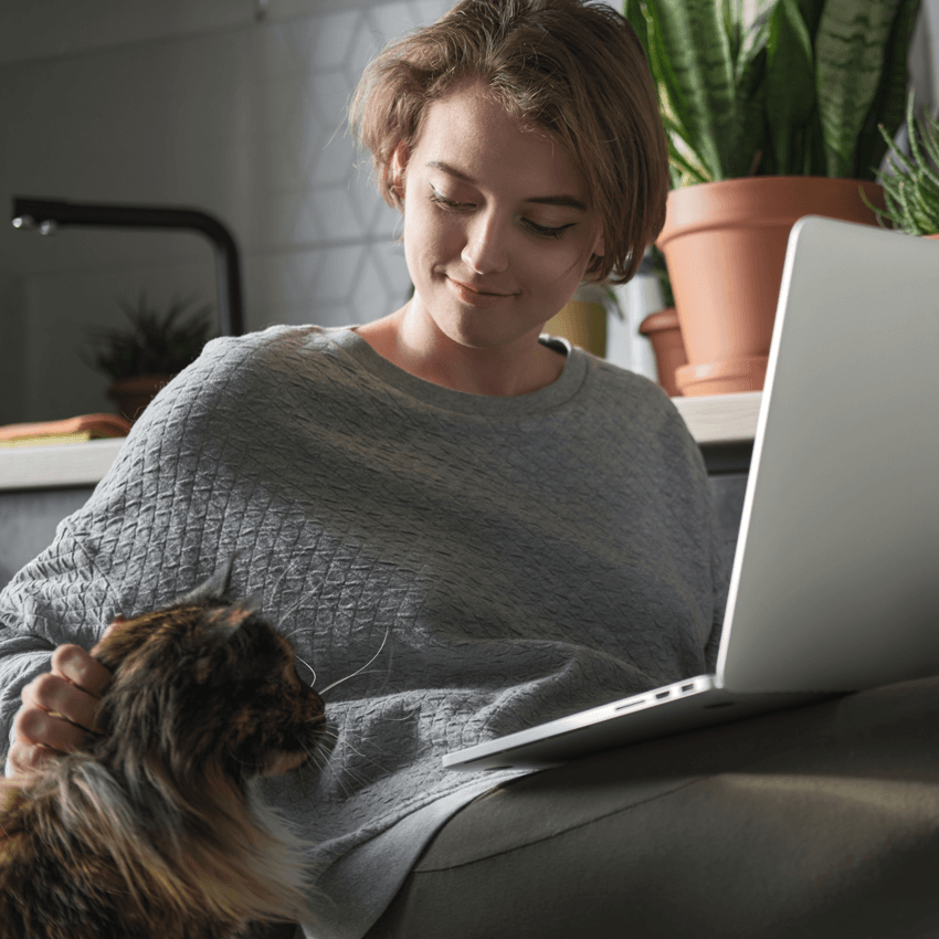 woman-with-cat-and-laptop-at-home